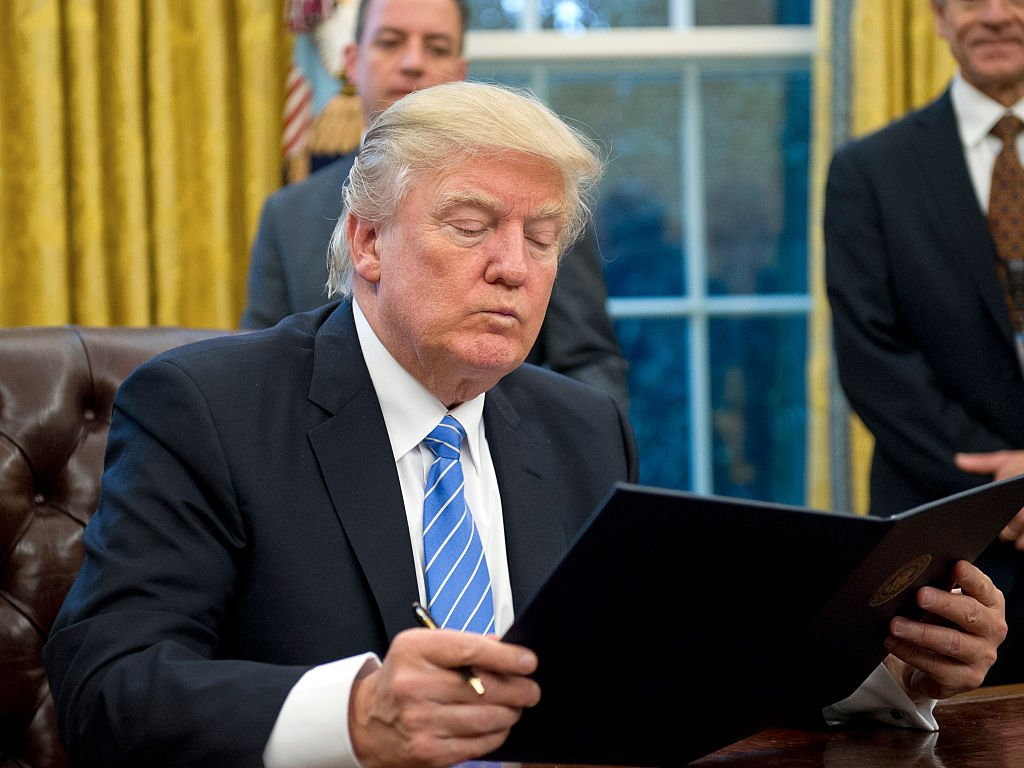 Donald Trump reading bill